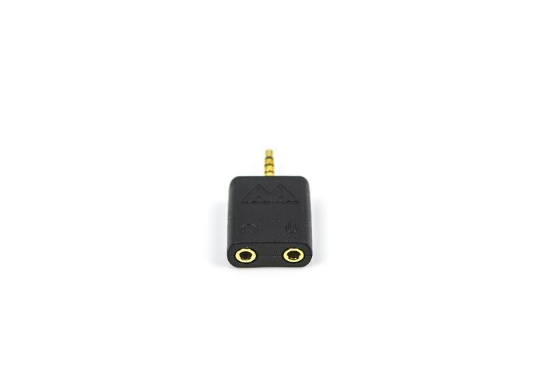 L'adaptateur qui s'insère dans la prise d'écouteurs de votre téléphone, votre tablette ou votre ordinateur